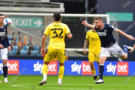 Stock Photo of Matty James, Alex Pearce during the EFL Sky Bet Championship match between Millwall and Barnsley at The Den, London