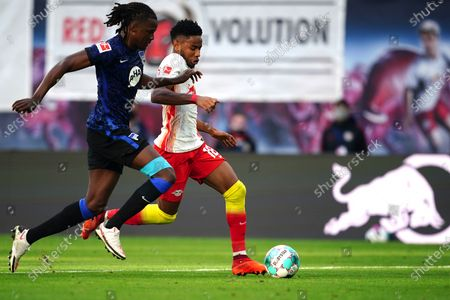 Hertha's Dedryck Boyata (L) in action against Leipzig's Christopher Nkunku (R) during the German Bundesliga soccer match between RB Leipzig and Hertha BSC Berlin in Leipzig, Germany, 24 October 2020.
