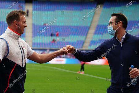 Leipzig's head coach Julian Nagelsmann (L) greets Hertha's managing director Michael Preetz (R) prior to the German Bundesliga soccer match between RB Leipzig and Hertha BSC Berlin in Leipzig, Germany, 24 October 2020.