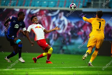 Leipzig's Christopher Nkunku (2-L) in action against Hertha players Dedryck Boyata (L) and goalkeeper Alexander Schwolow (R) during the German Bundesliga soccer match between RB Leipzig and Hertha BSC Berlin in Leipzig, Germany, 24 October 2020.
