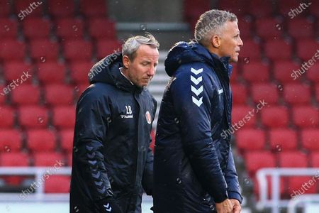 Charlton Athletic manager Lee Bowyer and Northampton Town manager Keith Curle during the EFL Sky Bet League 1 match between Northampton Town and Charlton Athletic at the PTS Academy Stadium, Northampton