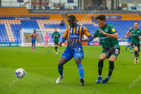 Daniel Udoh of Shrewsbury Town and Haydon Roberts of Rochdale during the EFL Sky Bet League 1 match between Shrewsbury Town and Rochdale at Greenhous Meadow, Shrewsbury