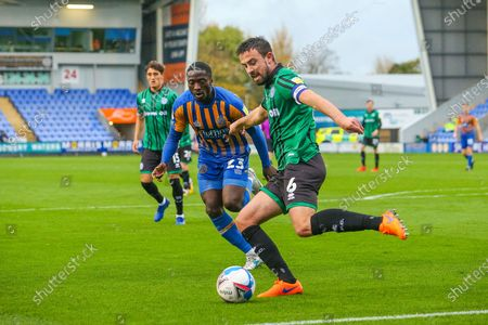 Eoghan O'Connell of Rochdale and Daniel Udoh of Shrewsbury Town during the EFL Sky Bet League 1 match between Shrewsbury Town and Rochdale at Greenhous Meadow, Shrewsbury