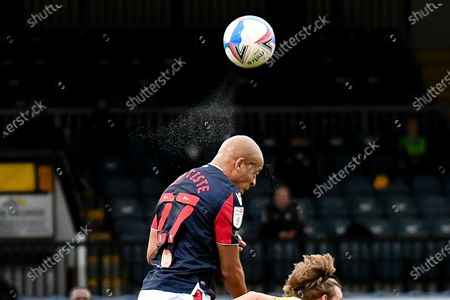 Bolton Wanderers defender Alex Baptiste (27) heads the ball during the EFL Sky Bet League 2 match between Cambridge United and Bolton Wanderers at the Cambs Glass Stadium, Cambridge