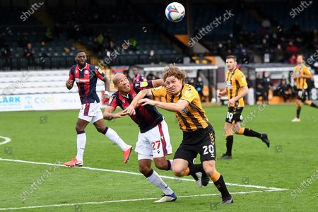 Bolton Wanderers defender Alex Baptiste (27) battles for possession  with Cambridge United forward Joe Ironside (20) during the EFL Sky Bet League 2 match between Cambridge United and Bolton Wanderers at the Cambs Glass Stadium, Cambridge