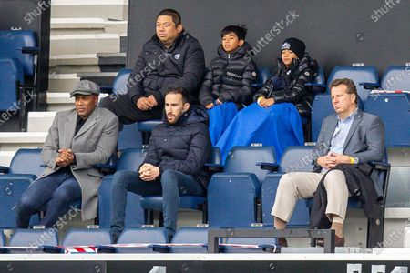 Queens Park Rangers vice chairman Ruben Gnanalingam (back left), Queens Park Rangers director of football Les Ferdinand (front left), Queens Park Rangers press and publications manager Matt Webb (front middle), Queens Park Rangers CEO Lee Hoos (front right) during the EFL Sky Bet Championship match between Queens Park Rangers and Birmingham City at the Kiyan Prince Foundation Stadium, London