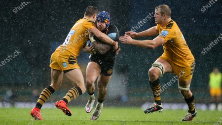 Jack Nowell of Exeter is stopped by Josh Bassett of Wasps & Joe Launchbury (Captain) of Wasps