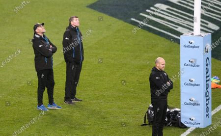 Exeter's Director of Rugby Rob Baxter (2nd L) watch warm up