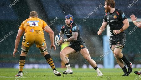 Jack Nowell of Exeter attacks Joe Launchbury (Captain) of Wasps