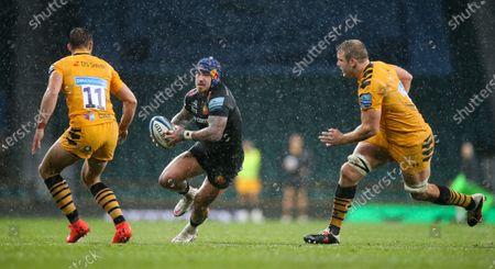 Jack Nowell of Exeter attacks Joe Launchbury (Captain) of Wasps & Josh Bassett of Wasps