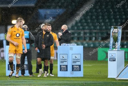 Joe Launchbury (Captain) of Wasps picks up his medal and walks past the trophy after defeat
