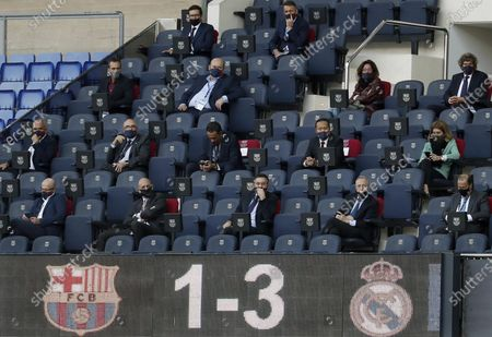 FC Barcelona's president Josep Maria Bartomeu (front row, C) and Real Madrid's president Florentino Perez (C-R) attend the Spanish La Liga soccer match between FC Barcelona and Real Madrid, traditionally known as 'El Clasico', at Nou Camp in Barcelona, Spain, 24 October 2020.