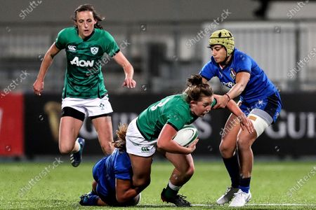 Stock Image of Ireland Women vs Italy Women. Ireland's Enya Breen is tackled by Sara Tounesi and Beatrice Rigoni of Italy