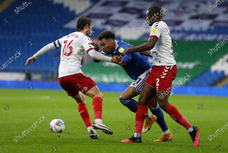 Josh Murphy of Cardiff City is tackled by Jonathan Howson and Anfernee Dijksteel of Middlesbrough.