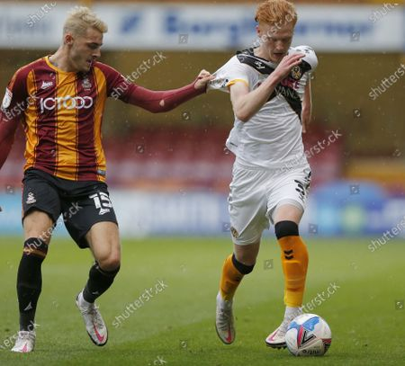 Ryan Haynes of Newport County and Tyler French of Bradford City