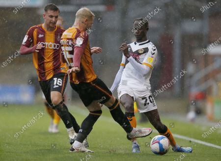 Saikou Janneh of Newport County and Tyler French of Bradford City