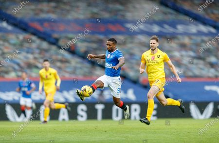 Jermain Defoe of Rangers controls the ball ahead of Jon Guthrie of Livingston during the Scottish Premiership match between Rangers & Livingston at Ibrox Stadium, Glasgow on 25 Oct 2020