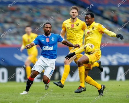 Jermain Defoe of Rangers beats Efe Ambrose of Livingston during the Scottish Premiership match between Rangers & Livingston at Ibrox Stadium, Glasgow on 25 Oct 2020