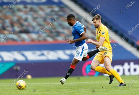 Jermain Defoe of Rangers, cased by Jon Guthrie of Livingston, scores to give Rangers a 2-0 lead during the Scottish Premiership match between Rangers & Livingston at Ibrox Stadium, Glasgow on 25 Oct 2020