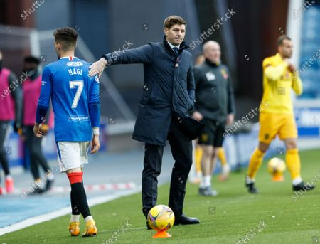 Ianis Hagi of Rangers gets a pat on the back from Rangers Manager Steven Gerrard as he is substituted during the Scottish Premiership match between Rangers & Livingston at Ibrox Stadium, Glasgow on 25 Oct 2020