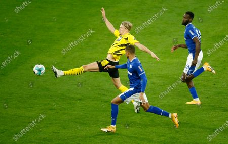 Dortmund's Erling Haaland (L) in action against Schalke players Malick Thiaw (C) and Salif Sane (R) during the German Bundesliga soccer match between Borussia Dortmund and FC Schalke 04 in Dortmund, Germany, 24 October 2020.
