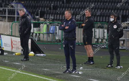Stock Image of Peterborough United Manager Darren Ferguson watches on from the touchline alongside Hull City manager Grant McCann