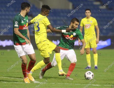 Al-Ittifaq player Naim Sliti (C-R) in action against Al-Ain player Hassan Al-Harbi (C-L) during the Saudi Professional League soccer match between Al-Ittifaq and Al-Ain at Prince Mohamed bin Fahd Stadium, in Dammam, Saudi Arabia, 24 October 2020.