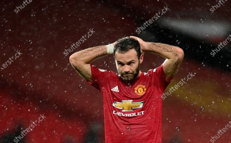 Manchester United's Juan Mata reacts during the English Premier League soccer match between Manchester United and Chelsea, at the Old Trafford stadium in Manchester, England