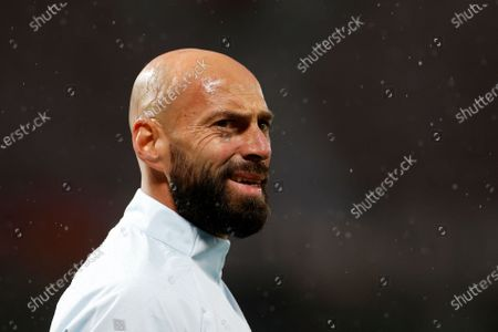 Chelsea's goalkeeper Willy Caballero looks on during warm up before the English Premier League soccer match between Manchester United and Chelsea, at the Old Trafford stadium in Manchester, England