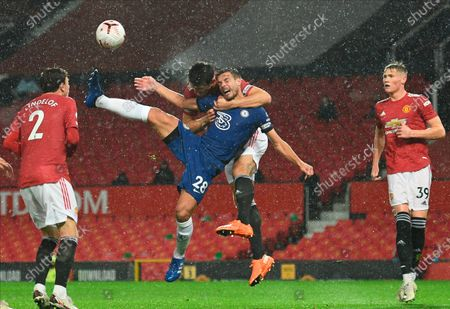 Harry Maguire (back C) of Manchester United in action against Chelsea's Cesar Azpilicueta (C) during the English Premier League soccer match between Manchester United and Chelsea FC in Manchester, Britain, 24 October 2020.