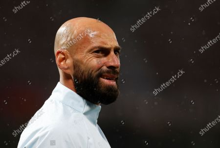 Chelsea's goalkeeper Willy Caballero warms up for the English Premier League soccer match between Manchester United and Chelsea FC in Manchester, Britain, 24 October 2020.