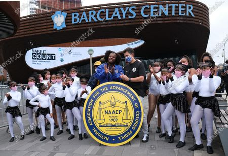 Stock Image of L. Joy Williams from the Brooklyn chapter of the NAACP and Barclays CEO John Abbamondi address the media regarding early voting at Barclays Center in Brooklyn, NYC.