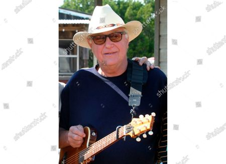 """Country singer Jerry Jeff Walker at a campaign fundraiser at Willie Nelson's ranch outside Austin, Texas. The Texas country singer and songwriter who wrote the pop song """"Mr. Bojangles,"""" has died at age 78. Family spokesman John T. Davis says Walker died of cancer after battling throat cancer and other health issues for several years"""