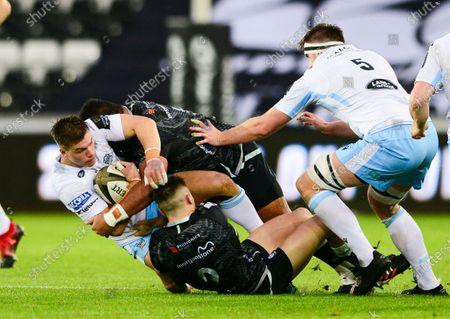 Ospreys vs Glasgow Warriors. Glasgow's Huw Jones is tackled by James King of Ospreys
