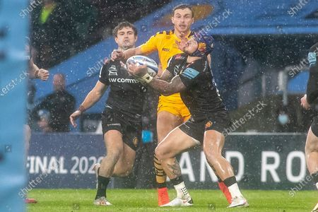 Exeter's Jack Nowell collects the ball under pressure from Wasps Josh Bassett during the Gallagher Premiership Rugby match between Exeter Chiefs and Wasps at Twickenham, Richmond