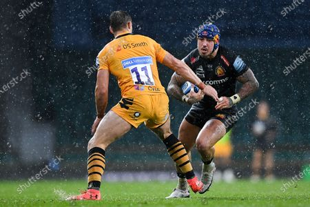 Jack Nowell of Exeter Chiefs is challenged by Josh Bassett of Wasps