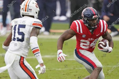 Mississippi running back Snoop Conner (24) avoids a tackle attempt by Auburn defensive back Jordyn Peters (15) during the second half of an NCAA college football game in Oxford, Miss., . Auburn won 35-28
