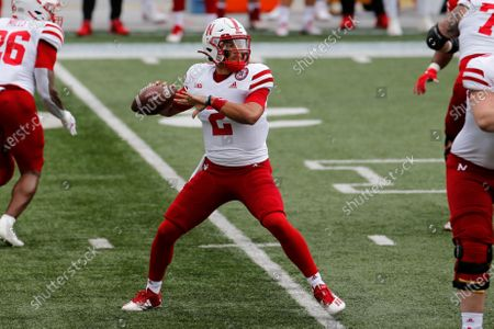 Stock Image of Nebraska quarterback Adrian Martinez throws a pass against Ohio State during the first half of an NCAA college football game, in Columbus, Ohio