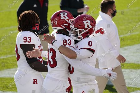 Rutgers quarterback Noah Vedral (0) hugs teammate wide receiver Isaiah Washington (83) after their 38-27 win over Michigan State in an NCAA college football game, in East Lansing, Mich