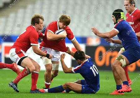 James Davies of Wales bumps off Romain Ntamack of France.