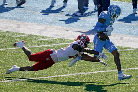 North Carolina wide receiver Dyami Brown (2) loses the ball while North Carolina State cornerback Malik Dunlap (24) defends during the first half of an NCAA college football game in Chapel Hill, N.C