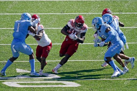 North Carolina State running back Zonovan Knight (7) finds some running room against North Carolina during the first half of an NCAA college football game in Chapel Hill, N.C