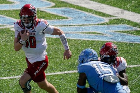 North Carolina State quarterback Ben Finley (10) runs the ball against North Carolina during the first half of an NCAA college football game in Chapel Hill, N.C