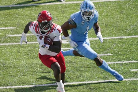 North Carolina State wide receiver Emeka Emezie (86) runs the ball while North Carolina defensive back Kyler McMichael (1) chases during the first half of an NCAA college football game in Chapel Hill, N.C