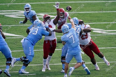 North Carolina State rushes North Carolina quarterback Sam Howell (7) during the first half of an NCAA college football game in Chapel Hill, N.C