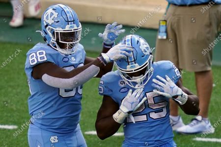 North Carolina tight end Kamari Morales (88) congratulates running back Javonte Williams (25) following Williams' touchdown against North Carolina State during the second half of an NCAA college football game in Chapel Hill, N.C