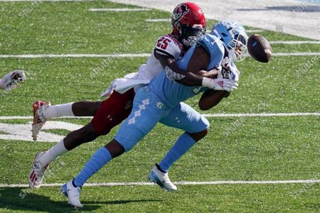 North Carolina State cornerback Shyheim Battle (25) hits North Carolina wide receiver Khafre Brown (1) during the second half of an NCAA college football game in Chapel Hill, N.C