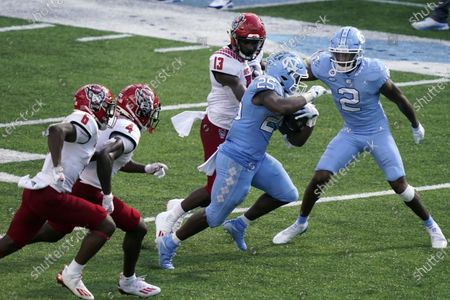 North Carolina running back Javonte Williams (25) runs the ball for a touchdown against North Carolina State during the second half of an NCAA college football game in Chapel Hill, N.C