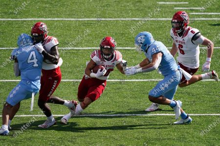 North Carolina State running back Jordan Houston (20) gets a block from wide receiver Porter Rooks (14) while North Carolina linebacker Jeremiah Gemmel (44) and defensive back Trey Morrison (4) defend during the second half of an NCAA college football game in Chapel Hill, N.C