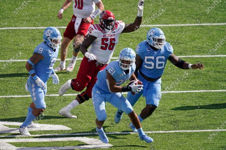 North Carolina linebacker Chazz Surratt (21) grabs an interception against North Carolina State during the second half of an NCAA college football game in Chapel Hill, N.C